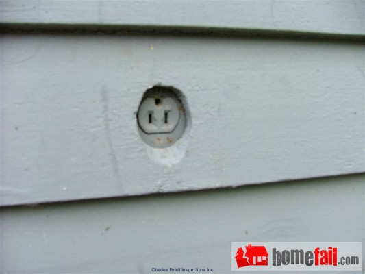 obscured electrical outlet